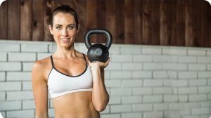 Beachbody Blog Autumn Calabrese Holding Kettlebell Upright Row 21 Day Fix