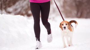 woman running with dog holiday