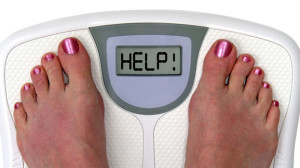 woman gaining weight scale