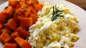 Scrambled egg whites with steamed sweet potatoes breakfast recipe.
