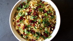 Quinoa stuffing recipe with apples, cranberries, and pine nuts