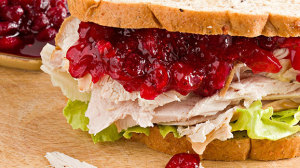 Healthy ways to use Thanksgiving leftovers, like this turkey and cranberry sauce sandwich on whole grain bread.