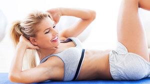 Finding a minute for exercise. Woman doing abdominal exercises.