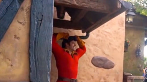 Beauty and the Beast villain Gaston dominates a push-up contest with theme park guest