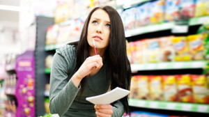 Quick Tip Cut Grocery Shopping Time Woman at Grocery Store