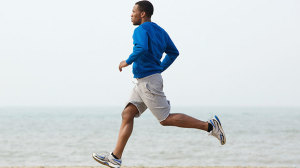 Guy running on a beach is running bad for you