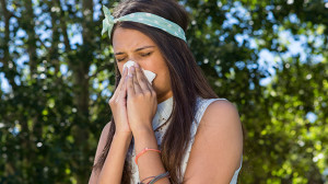 How to Get Rid of a Cold woman sneezing