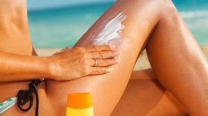 Thighbrow woman on beach sunscreen