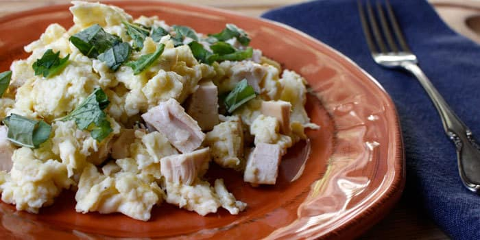 Egg white scramble with chicken and herbs, healthy high-protein breakfast recipe.