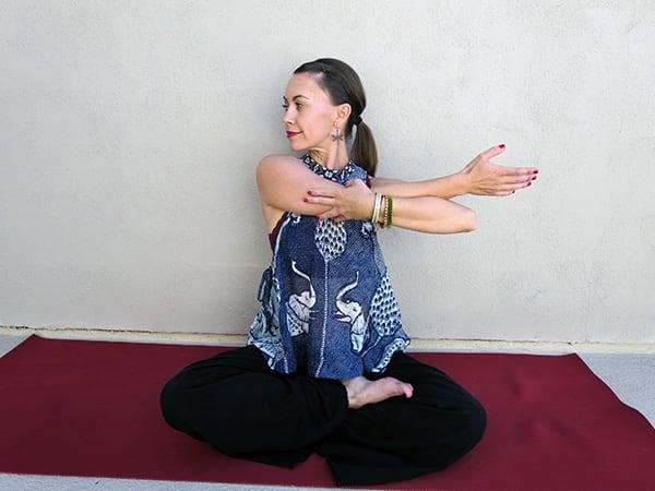 Arm Across Chest pose shoulder pain yoga