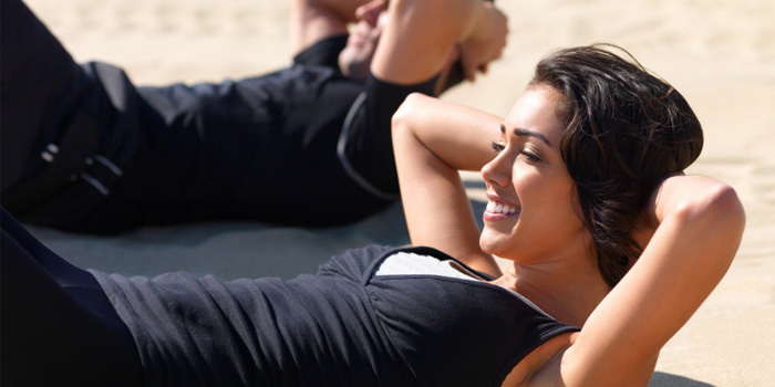 What is the best time of day to exercise woman working out on the beach