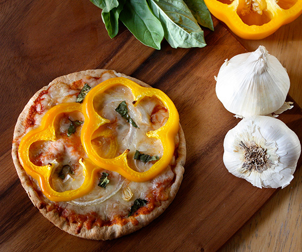 Pita pizza with yellow bell pepper and onion