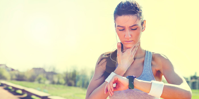 Why Your Heart Rate Stays High After A Workout Runner Woman Checking Her Pulse