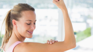 boost your body image woman loving her bicep