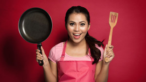 How to Cook Anything Even if You Have a Bare Bones Kitchen Woman With Spatula and Frying Pan