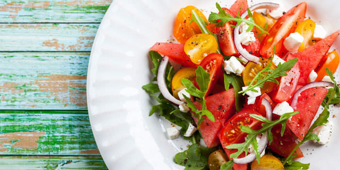 watermelon and heirloom tomato salad with arugula and feta