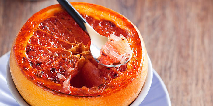 Broiled grapefruit with orange liqueur and cinnamon