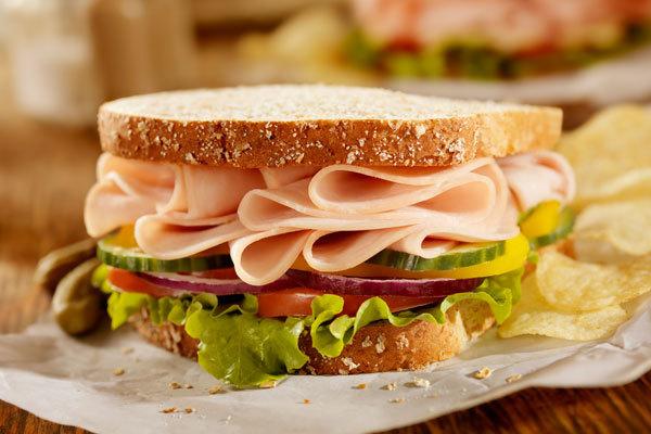 Deli meat sandwich on whole wheat bread