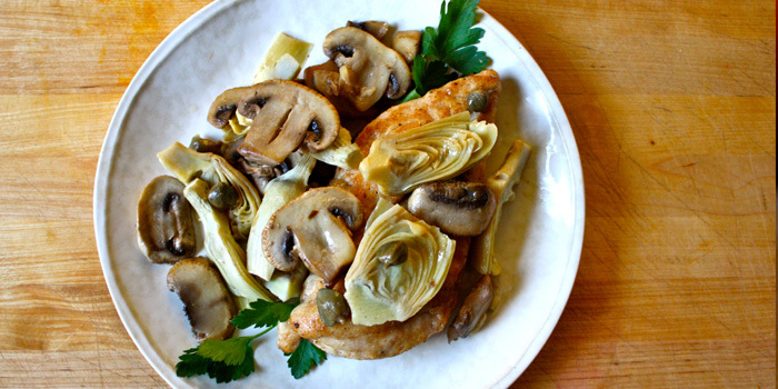 ... chicken piccata recipe is topped with mushrooms artichokes and capers