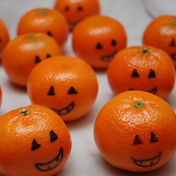 Jack O' Lanterns drawn on clementines Halloween Snack